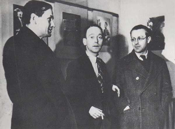 war two artists Gustav Regler, John Heartfield, Tristan Tzara, Paris, 1935