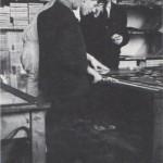Heartfield working at the AIZ, Prague, 1936
