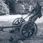 John Heartfield playfully riding a farm implement