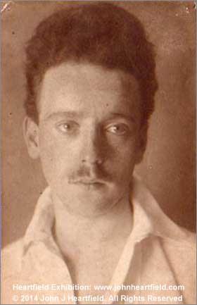Artist John Heartfield Bio Dada & anti-fascist collage artist photo 1912